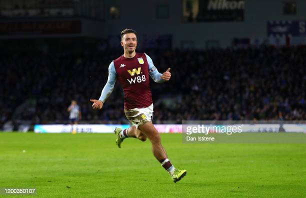 Jack Grealish of Aston Villa celebrates after scoring his team's first goal during the Premier League match between Brighton & Hove Albion and Aston...