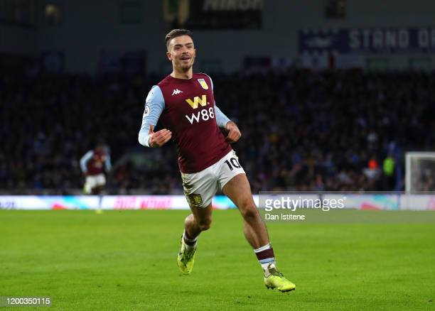 Jack Grealish of Aston Villa celebrates after scoring his team's first goal during the Premier League match between Brighton Hove Albion and Aston...