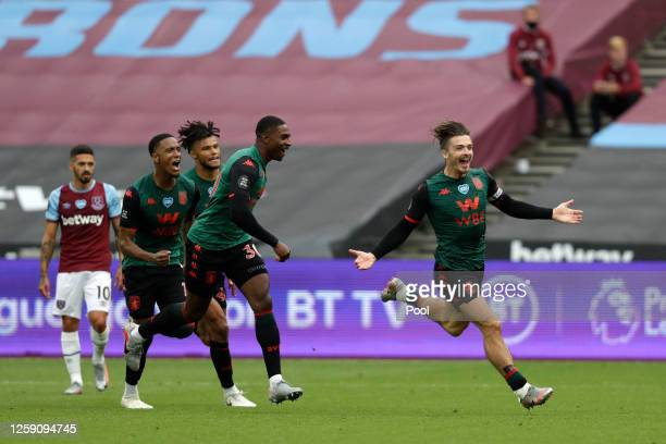 Jack Grealish of Aston Villa celebrates after scoring his team's first goal during the Premier League match between West Ham United and Aston Villa...