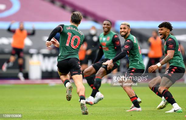 Jack Grealish of Aston Villa celebrates after scoring the first goal with team mates Tyrone Mings of Aston Villa and Douglas Luiz of Aston Villa...