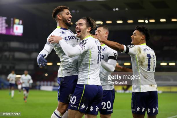 Jack Grealish of Aston Villa celebrates after scoring their sides second goal with team mate Douglas Luiz during the Premier League match between...