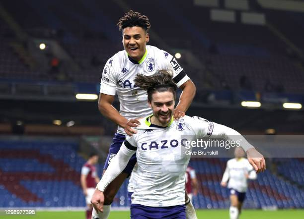 Jack Grealish of Aston Villa celebrates after scoring their sides second goal with team mate Ollie Watkins during the Premier League match between...