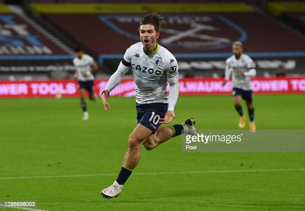 Jack Grealish of Aston Villa celebrates after scoring their team's first goal during the Premier League match between West Ham United and Aston Villa...
