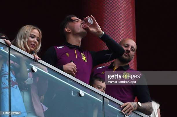Jack Grealish of Aston Villa celebrates from a hotel balcony with fans in the street following his team's victory in the Sky Bet Championship Playoff...
