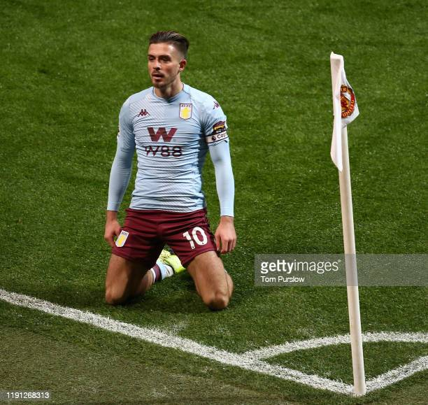 Jack Grealish of Aston VIlla celebrates scoring their first goal during the Premier League match between Manchester United and Aston Villa at Old...