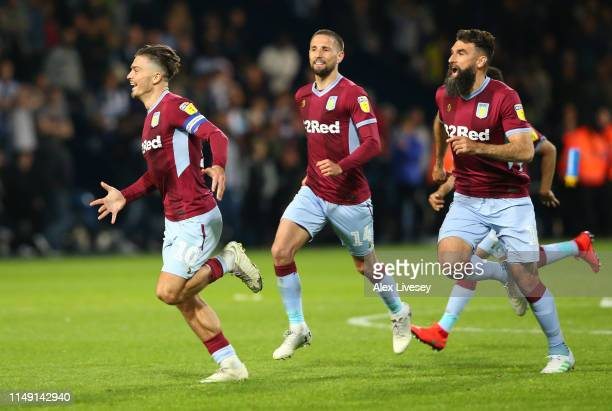 Jack Grealish of Aston Villa celebrates victory in the penalty shoot out with team mates Conor Hourihane and Mile Jedinak during the Sky Bet...