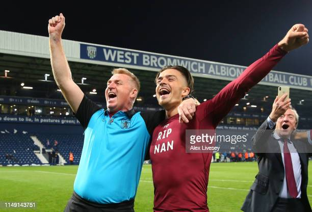 Jack Grealish of Aston Villa celebrates victory in the penalty shoot out with Dean Smith Manager of Aston Villa after the Sky Bet Championship...