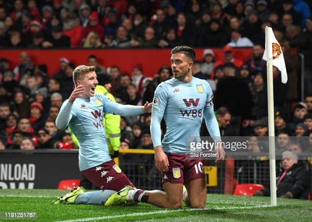 Jack Grealish of Aston Villa celebrates with his team after he scores his sides first goal during the Premier League match between Manchester United...