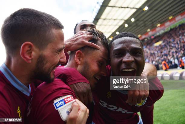 Jack Grealish of Aston Villa celebrates with his teammates after scoring his sides first goal during the Sky Bet Championship match between...