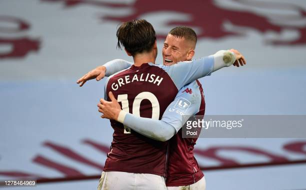 Jack Grealish of Aston Villa celebrates with Ross Barkley of Aston Villa after scoring his teams 6th goal during the Premier League match between...