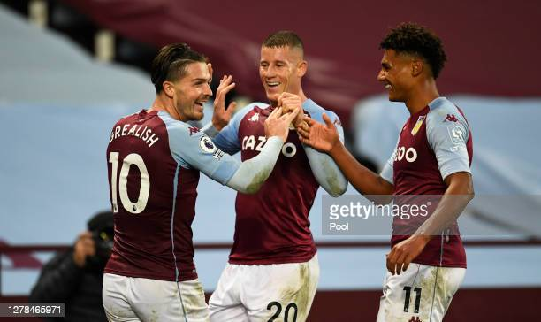 Jack Grealish of Aston Villa celebrates with Ross Barkley of Aston Villa and Ollie Watkins of Aston Villa after he scores his sides 7th goal during...