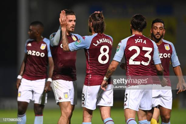 Jack Grealish of Aston Villa celebrates with teammates after scoring his team's second goal during the Carabao Cup Second Round match between Burton...