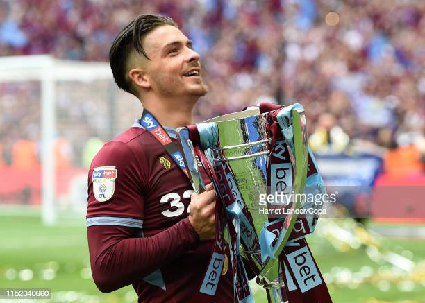 Jack Grealish of Aston Villa celebrates with the Sky Bet Championship Playoff Final Trophy following his team's victory in the Sky Bet Championship...