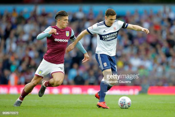 Jack Grealish of Aston Villa challenges Stewart Downing of Middlesbrough during the Sky Bet Championship Play Off Semi FinalSecond Leg match between...