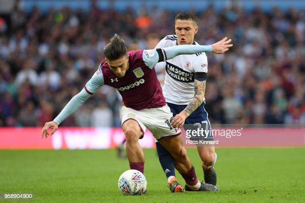 Jack Grealish of Aston Villa collides with Mo Besic of Middlesbrough during the Sky Bet Championship Play Off Semi Final second leg match between...