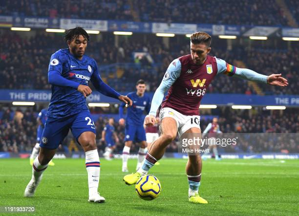 Jack Grealish of Aston Villa controls the ball under pressure from Reece James of Chelsea during the Premier League match between Chelsea FC and...