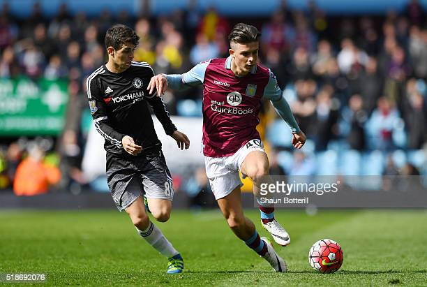 Jack Grealish of Aston Villa controls the ball under pressure of Oscar of Chelsea during the Barclays Premier League match between Aston Villa and...