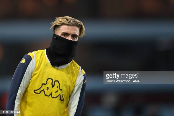 Jack Grealish of Aston Villa covering his face with a snood during the Carabao Cup Quarter Final match between Aston Villa and Liverpool FC at Villa...