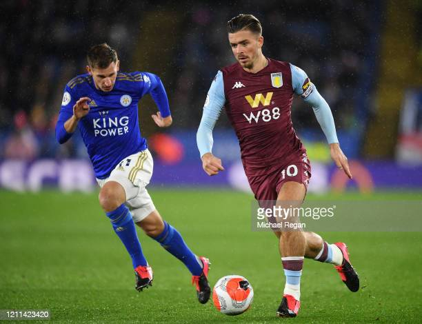 Jack Grealish of Aston Villa gets past the tackle from Marc Albrighton of Leicester City during the Premier League match between Leicester City and...