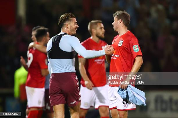Jack Grealish of Aston Villa gives his shirt to James Jones of Crewe Alexandra during the Carabao Cup Second Round fixture between Crewe Alexandra...