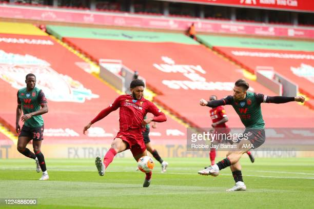 Jack Grealish of Aston Villa has a shot on goal during the Premier League match between Liverpool FC and Aston Villa at Anfield on July 5 2020 in...