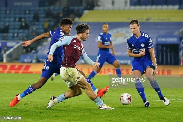 Jack Grealish of Aston Villa has his shot blocked by Wesley Fofana of Leicester City and Jonny Evans of Leicester City during the Premier League...