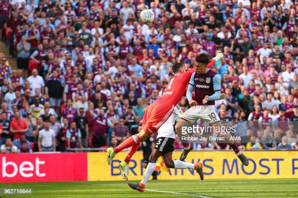 Jack Grealish of ASton Villa heads over the bar during the Sky Bet Championship Play Off Final between Aston Villa and Fulham at Wembley Stadium on...