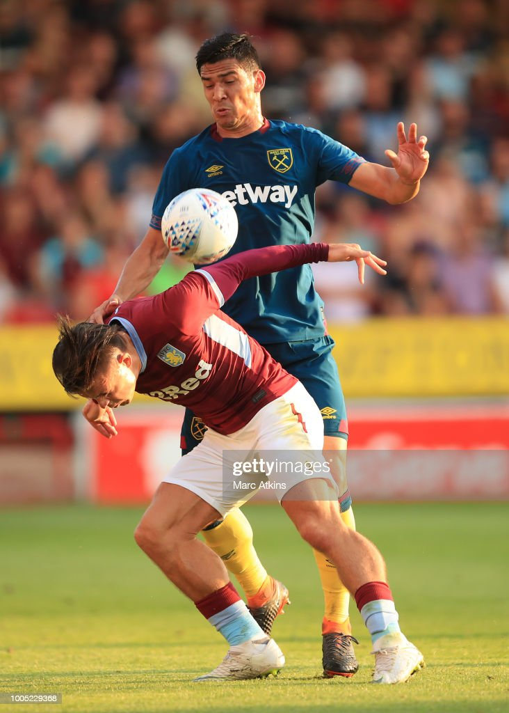 Jack Grealish of Aston Villa in action with Fabian Balbuena of West Ham during the Pre-Season Friendly between Aston Villa v West Ham United at Banks' Stadium on July 25, 2018 in Walsall, England.