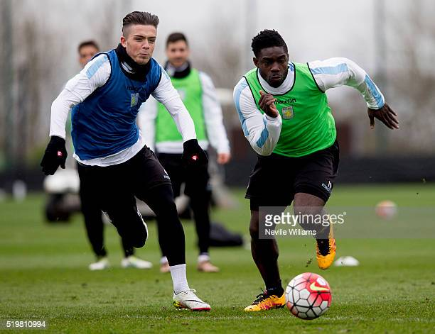 Jack Grealish of Aston Villa in action with team mate Micah Richards during a Aston Villa training session at the club's training ground at Bodymoor...