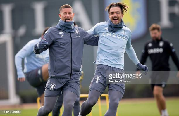 Jack Grealish of Aston Villa in action with team mate Ross Barkley during a training session at Bodymoor Heath training ground on November 06, 2020...
