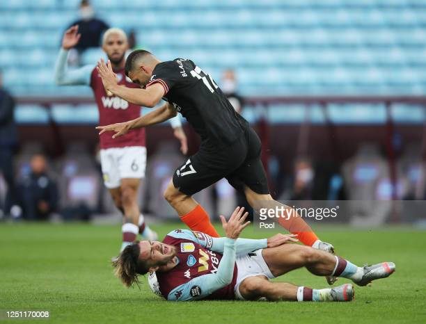 Jack Grealish of Aston Villa is brought down by Mateo Kovacic of Chelsea during the Premier League match between Aston Villa and Chelsea FC at Villa...