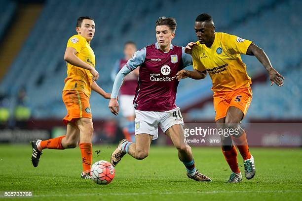 Jack Grealish of Aston Villa is challenged by Anthony Stewart of Wycombe Wanderers during the FA Cup Third Round Relay match between Aston Villa and...