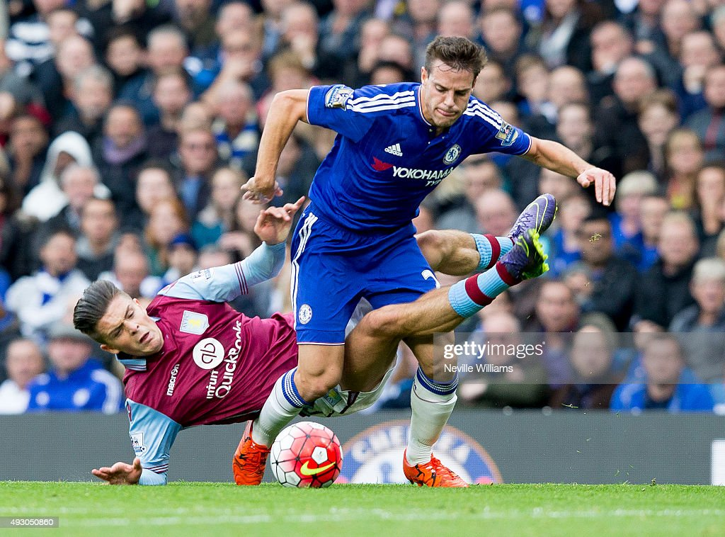 Jack Grealish of Aston Villa is challenged by Cesar Azpilicueta of Chelsea during the Barclays Premier League match between Chelsea and Aston Villa at Stamford Bridge on October 17, 2015 in London, England.