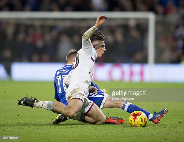 Jack Grealish of Aston Villa is challenged by Craig Noone of Cardiff City during the Sky Bet Championship match between Cardiff City and Aston Villa...