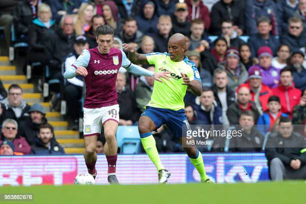 Aston Villa v Derby County Sky Bet ChampionshipnBIRMINGHAM ENGLAND APRIL 28 Jack grealish of Aston Villa is challenged by Derby's Andre Wisdom