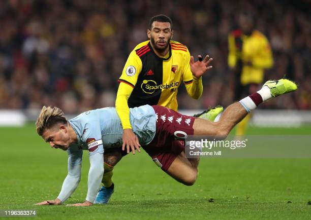 Jack Grealish of Aston Villa is challenged by Etienne Capoue of Watford during the Premier League match between Watford FC and Aston Villa at...