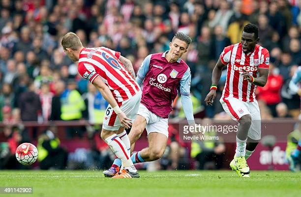 Jack Grealish of Aston Villa is challenged by Glenn Whelan of Stoke City during the Barclays Premier League match between Aston Villa and Stoke City...