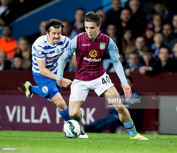 Jack Grealish of Aston Villa is challenged by Joey Barton of Queens Park Rangers during the Barclays Premier League match between Aston Villa and...