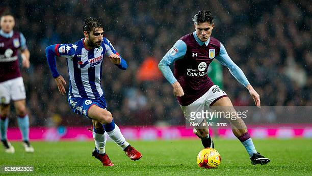 Jack Grealish of Aston Villa is challenged by Jordi Gomez of Wigan Athletic during the Sky Bet Championship match between Aston Villa and Wigan...