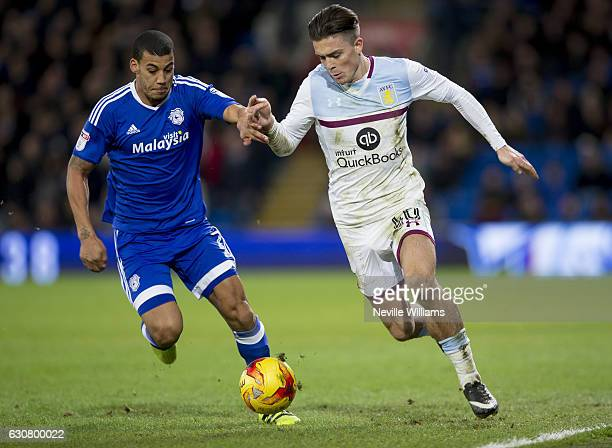 Jack Grealish of Aston Villa is challenged by Lee Peltier of Cardiff City during the Sky Bet Championship match between Cardiff City and Aston Villa...