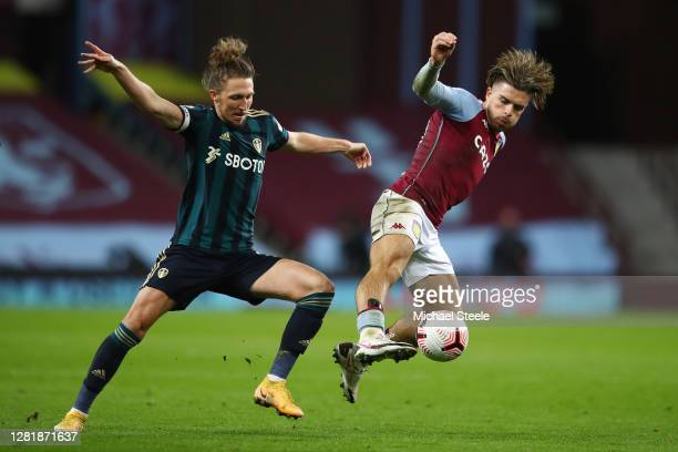 Jack Grealish of Aston Villa is challenged by Luke Ayling of Leeds United during the Premier League match between Aston Villa and Leeds United at...