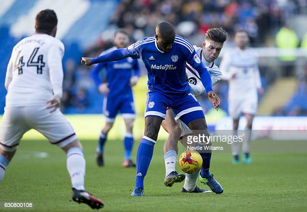 Jack Grealish of Aston Villa is challenged by Sol Bamba of Cardiff City during the Sky Bet Championship match between Cardiff City and Aston Villa at...