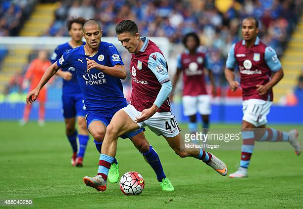 Jack Grealish of Aston Villa is chased by Gokhan Inler of Leicester City during the Barclays Premier League match between Leicester City and Aston...