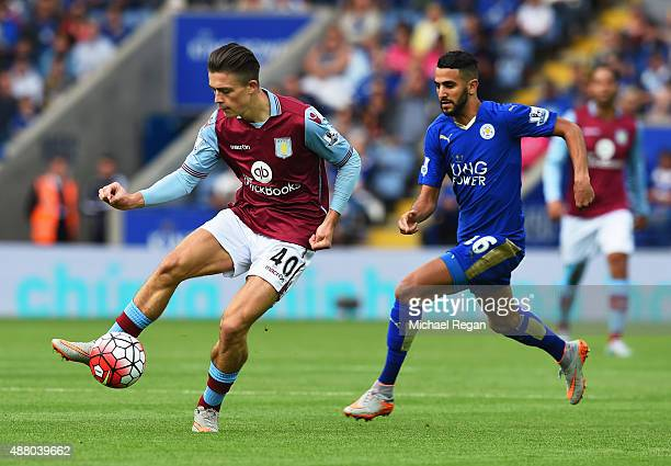 Jack Grealish of Aston Villa is chased by Riyad Mahrez of Leicester City during the Barclays Premier League match between Leicester City and Aston...