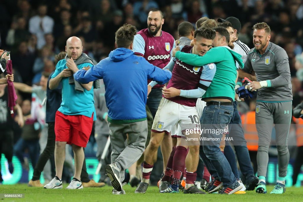 Jack Grealish of Aston Villa is mobbed by Aston Villa fans at full time of the Sky Bet Championship Play Off Semi Final:Second Leg match between Aston Villa and Middlesbrough at Villa Park on May 15, 2018 in Birmingham, England.