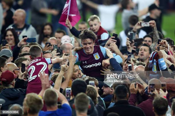 Jack Grealish of Aston Villa is seen at the full time whistle as fans invade the pitch during the Sky Bet Championship Play Off Semi Final second leg...