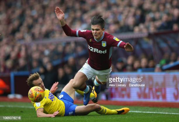 Jack Grealish of Aston Villa is tackled by Maikel Kieftenbeld of Birmingham City during the Sky Bet Championship match between Aston Villa and...
