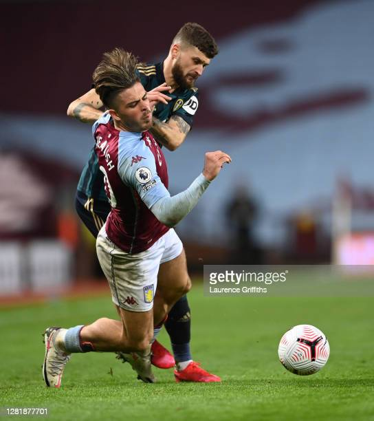 Jack Grealish of Aston Villa is tackled by Mateusz Klich of Leeds United during the Premier League match between Aston Villa and Leeds United at...