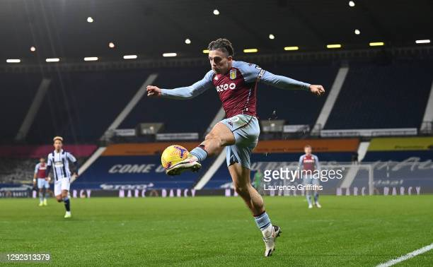 Jack Grealish of Aston Villa jumps to volley a shot at goal during the Premier League match between West Bromwich Albion and Aston Villa at The...