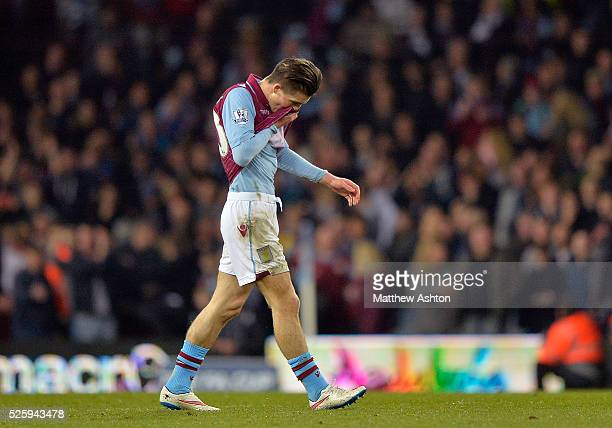 Jack Grealish of Aston Villa leaves the pitch after referee Anthony Taylor shows a red card to him